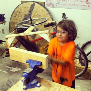 XXX learns more basic but rewarding ways of sawing. He was at it for a good half hour and could not have been a happier person if he were cutting into blocks of milk chocolate for consumption.