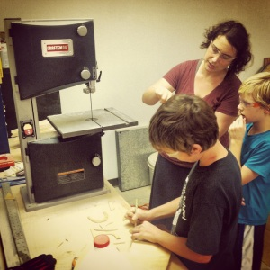 Jake and Kami teach XXX how to use the saw. He jumped right on it with a huge grin and cut away about a minute after this was shot. Easy peasy.