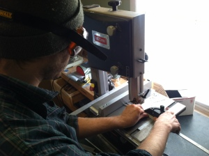 "Stu, making cuts into the meticulously machined skeleton ""bones"" with a bandsaw."