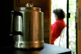 Coffee heating on the cast iron stove, reading on the porch. (Photo by Tona Williams)