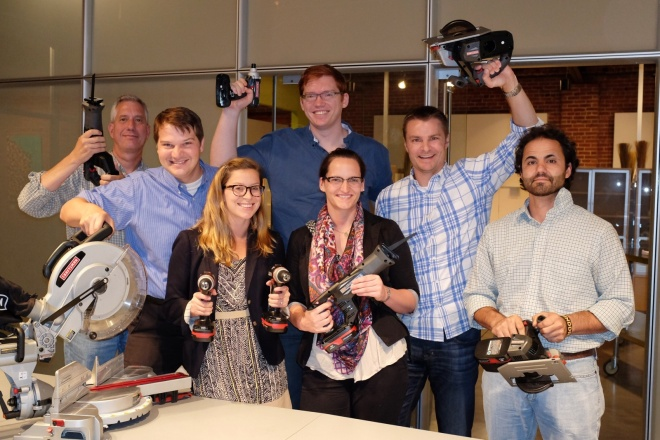 A very happy crew, just after receiving their shipment of donated tools in their Kansas City office.