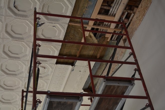 In case you were curious, the oldest ceiling layer is actually made of some kind of canvas-like fabric. Yes, fascinating. They aren't going to be able to restore it to that layer, but are keeping some of it as an artifact. We got up onto the scaffolding and geeked out on this one.